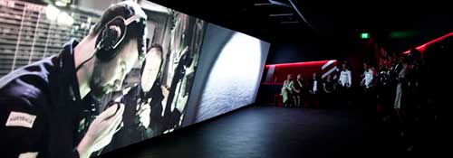 Visitors inside the immersive cinema experience
